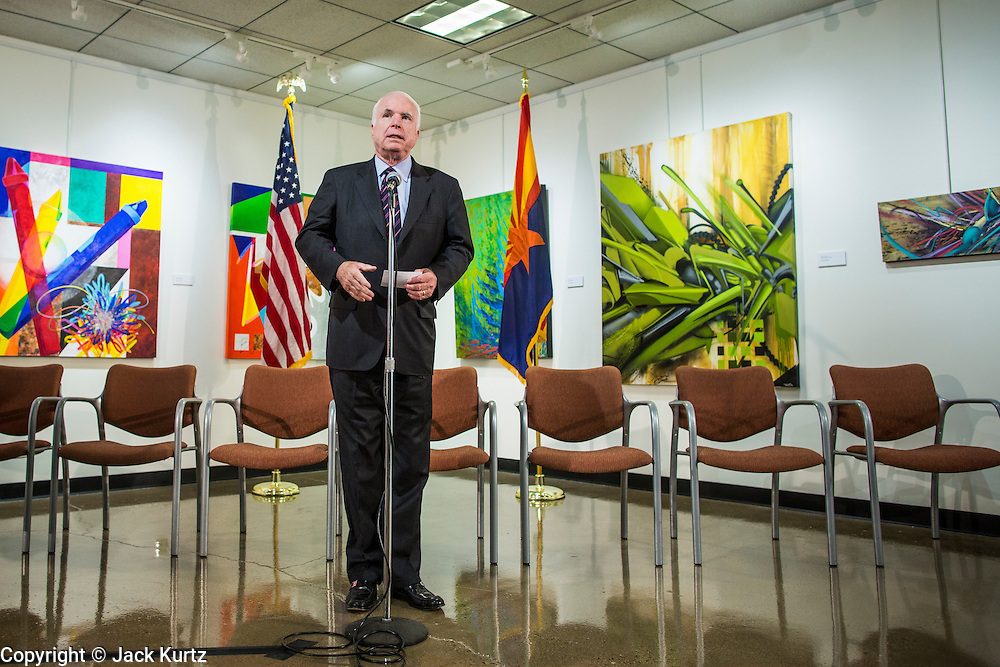 23 AUGUST 2012 - PEORIA, AZ: Senator JOHN McCAIN (R-AZ) approaches the microphone at a press conference in Peoria, AZ. Sen. McCain held a town hall in Peoria, AZ, a suburb of Phoenix, to talk about the impact that sequestration would have on the Arizona economy and the Department of Defense. McCain said sequestration would immediately cost Arizona more than 35,000 defence related jobs and decimate the armed forces. Sequestration would result in about $1.2 trillion being cut from the federal budget. Sequestration, and automatic budget cuts, is scheduled to go into effect on Jan 1, 2013, if the President and Congress can't agree on budget.      PHOTO BY JACK KURTZ