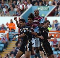 Photo: Ian Hebden.<br />Aston Villa v Charlton Athletic. The Barclays Premiership. 23/09/2006.<br />Charlton's Talal El Karkouri (L), Villa's Juan Pablo Angel, Luke Moore, Luke Young (R) contest for the ball.
