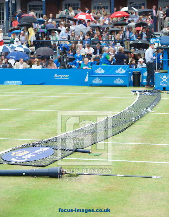 The net comes down before the players can finish their warm up for the match between Kevin Anderson of South Africa and Giles Simon of France in Aegon Championships at the Queen's Club, West Kensington<br /> Picture by Alan Stanford/Focus Images Ltd +44 7915 056117<br /> 20/06/2015