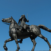 Side view of a large statue of Venezuelan leader Simon Bolivar, by Felix de Weldon, that stands in a park in front of the Interior Department in Foggy Bottom in northwest Washington DC. The statue was installed as a gift of the Venezuelan Government in 1955 and is formally titled Equestrian of Simon Bolivar.