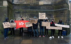 Edinburgh, Scotland, UK. 23rd November 2019.  Rally and march in support of Pro-Democracy movement in Hong Kong organised by the Democracy for Hong Kong in Scotland group started at St Giles Cathedral and proceeded along the Royal Mile to the Scottish Parliament. They attempted to hand over a letter asking for the Scottish Government to support the Pro-Democracy movement in Hong Kong but no MSP (Member of Scottish Parliament ) made themselves available to receive it. Iain Masterton/Alamy Live News.