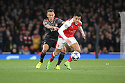 Bayern Munich defender Rafinha (13) battles for possession with Arsenal attacker Alexis Sanchez (7) during the Champions League round of 16, game 2 match between Arsenal and Bayern Munich at the Emirates Stadium, London, England on 7 March 2017. Photo by Matthew Redman.