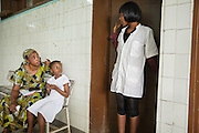A health worker speaks with patients at the Koumassi General Hospital in Abidjan, Cote d'Ivoire on Friday July 19, 2013.