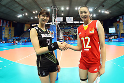 Japan captain Saori Kimura and China captain Hui Ruoqi shake hands before the match