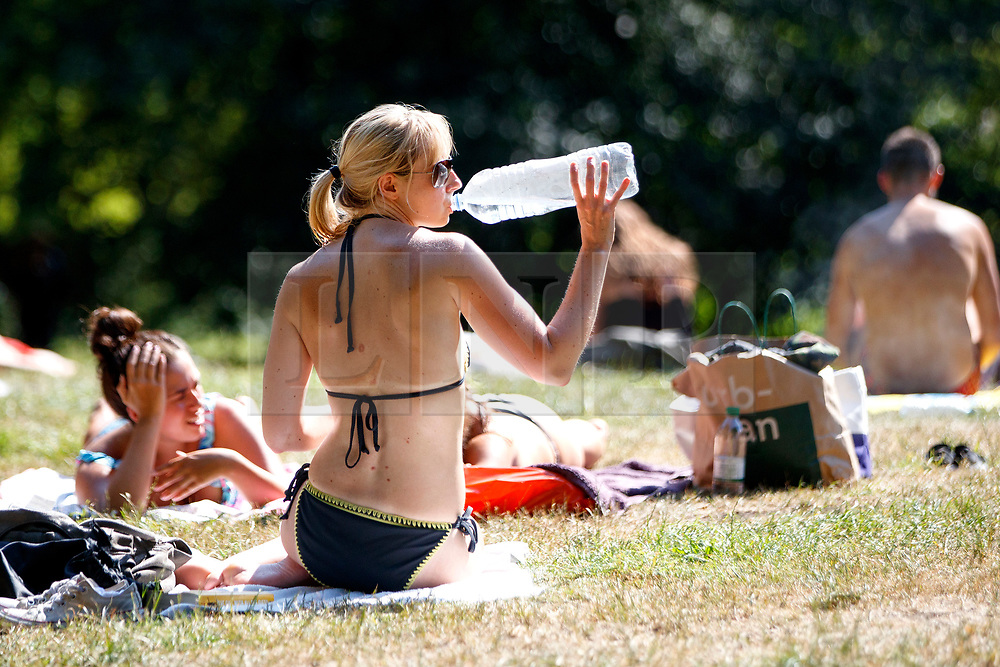 © Licensed to London News Pictures. 05/07/2017. London, UK. People sunbathe in Hampstead Heath in north London as temperatures hit 28C degrees on 5 July 2017. Photo credit: Tolga Akmen/LNP