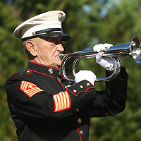 Adam Robison | BUY AT PHOTOS.DJOURNAL.COM<br /> Master Sergeant Bob Verell, US Marine Corps Retired, plays taps at the close of the Veterans Day Ceremony held at Veterans Park in Tupelo Wednesday morning.