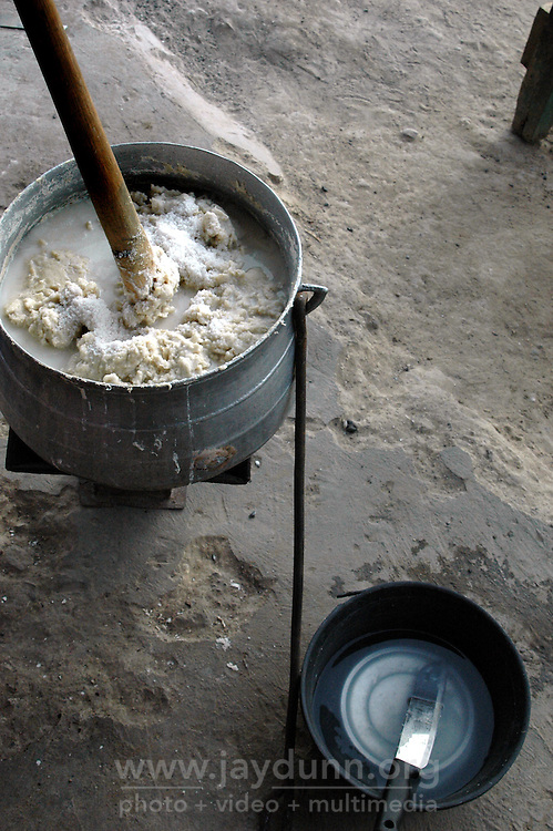GHANA,Accra,Kokomlemle, 2007. Banku is a staple food made from mashed cassava, which takes many hours of labor to prepare, and can be found everywhere in Ghana.
