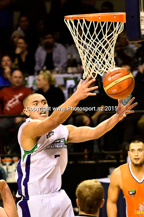 Reuben Te Rangi of the Super City Rangers makes a save during the NBL semi final basketball match between Southland and Super City Rangers at the TSB Arena in Wellington on Saturday the 4th of July 2015. Copyright photo by Marty Melville / www.Photosport.nz