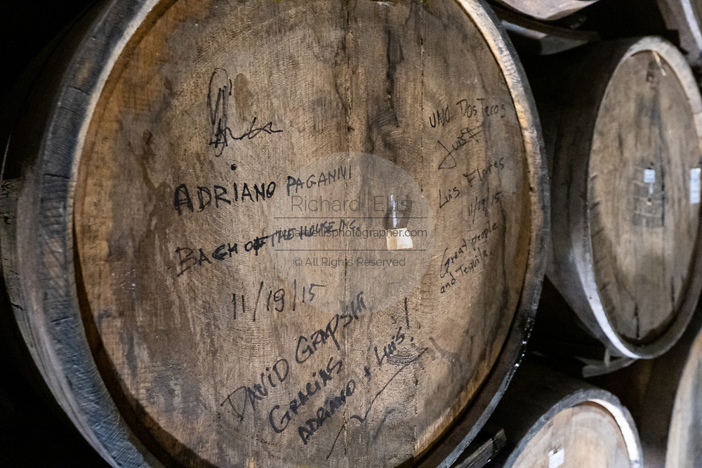 The name of a buyer written on a batch of aging tequila inside the barrel room at the Casa Siete Leguas, El Centenario tequila distillery in Atotonilco de Alto, Jalisco, Mexico. The tequila is aged from 2-12 years in white oak barrels that once held American Kentucky Bourbon. The Seven Leagues tequila distillery is the oldest family owned distillery producing authentic handcrafted tequila using traditional methods.