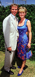 TV presenter ANTHEA TURNER and MR GRANT BOVEY, at a polo match in West Sussex on 18th July 1999.MUH 43
