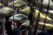 Young Asian mother poses for family picture with the new Olympic kinetic artwork called the Shoal at Stratford. 'The Shoal' at the Stratford Centre, east London, is made up of around 100 titanium clad 'leaves' mounted between 15 and 19 metres high on metal posts. Worth £13.5m, the Shoal is part of The Stratford Town Centre Public Realm Project, designed and manufacturered using 3D technology.