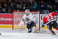 KELOWNA, CANADA - OCTOBER 4: Brendan Burke #1 of the Portland Winterhawks makes a save at the Kelowna Rockets on October 4, 2013 at Prospera Place in Kelowna, British Columbia, Canada (Photo by Marissa Baecker/Shoot the Breeze) *** Local Caption ***