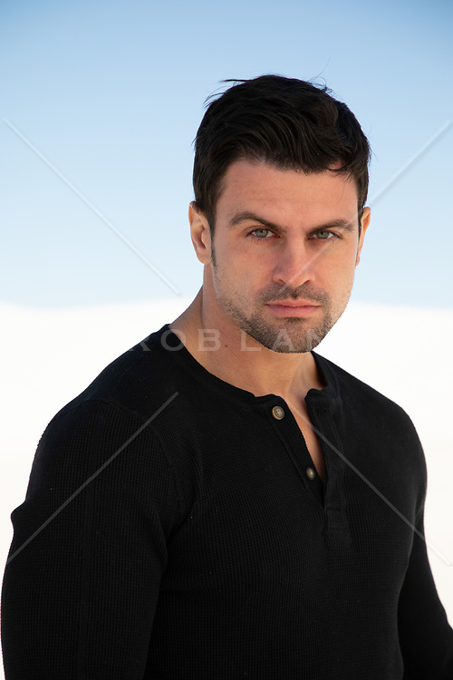 portrait of an All American man with green eyes and black hair
