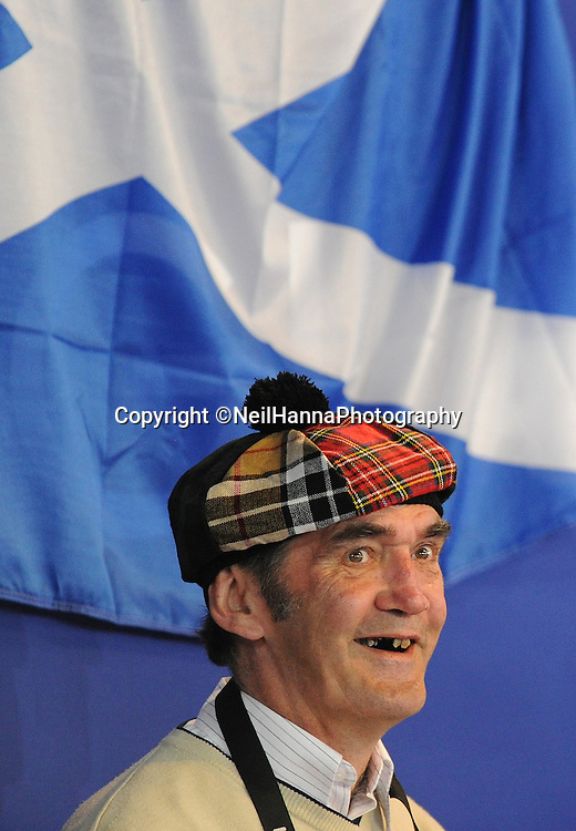 Commonwealth Games, Glasgow 2014<br /> SECC Wrestling<br /> A Scottish gent enjoying the Wrestling tonight, as Team Scotland add to their medal haul<br /> <br /> <br />  Neil Hanna Photography<br /> www.neilhannaphotography.co.uk<br /> 07702 246823