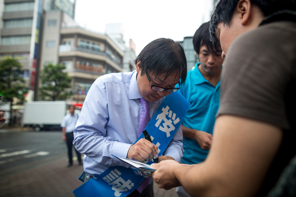 TOKYO, JAPAN - JULY 21 : Candidate Makoto Sakurai, a Japanese ultranationalist and far-right activist sign a book of his supporter after a campaign speech during a Tokyo Gubernatorial Election 2016 campaign rally at Omori station, Tokyo, Japan on Thursday, July 21, 2016. Tokyo residents will vote on July 31 for a new Governor of Tokyo who will deal with issues related to the hosting of the Tokyo Summer Olympics and Paralympics in 2020. (Photo: Richard Atrero de Guzman/NUR Photo)