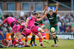 Rob Lewis of London Welsh box-kicks the ball as Jamie Gibson of Leicester Tigers looks to charge him down - Photo mandatory by-line: Patrick Khachfe/JMP - Mobile: 07966 386802 25/04/2015 - SPORT - RUGBY UNION - Leicester - Welford Road - Leicester Tigers v London Welsh - Aviva Premiership