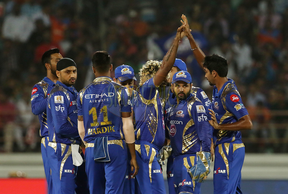 Mumbai Indians players celebrates the wicket of Aaron Finch of the Gujarat Lions during match 35 of the Vivo 2017 Indian Premier League between the Gujarat Lions and the Mumbai Indians  held at the Saurashtra Cricket Association Stadium in Rajkot, India on the 29th April 2017<br /> <br /> Photo by Vipin Pawar - Sportzpics - IPL