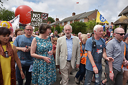 © Licensed to London News Pictures.  16/07/2017; Tolpuddle, Dorset, UK. JEREMY CORBYN, Leader of the Labour Party, lays a wreath at the grave of Tolpuddle Martyr James Hammett in Tolpuddle churchyard. Frances O' Grady, TUC General Secretary was also in attendance. Tolpuddle has been a place of great importance to the Labour Movement from the moment news broke of the harsh sentences imposed on the six farm workers who led the formation of the union in 1834. In 1834, farm workers in west Dorset formed a trade union. Unions were lawful and growing fast but six leaders of the union were arrested and sentenced to seven years' transportation for taking an oath of secrecy. Protests swept across the country. Thousands of people marched through London and many more organised petitions and protest meetings to demand their freedom. The Tolpuddle Martyrs Museum tells the story of the Martyrs arrest, trial and punishment, leading to the foundation of modern day trade unionism. Every year in July, thousands of people attend the Tolpuddle Martyrs' Festival for a weekend of family entertainment, stalls, political debate, comedy, music and a grand procession of trade unions with banners through the village. Picture credit : Simon Chapman/LNP