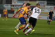 Mansfield Town forward Danny Rose (32) shoots at goal during the EFL Sky Bet League 2 match between Mansfield Town and Port Vale at the One Call Stadium, Mansfield, England on 26 December 2019.