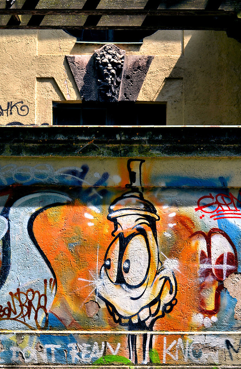 Graffiti and Cartoon Duck Mural under Gargoyle in Munich, Germany<br />