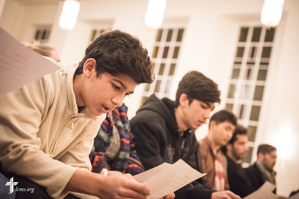 Refugees read through instructions during baptism rehearsal on Saturday, Nov. 14, 2015, at the Dreieinigkeits-Gemeinde, a SELK Lutheran church in Berlin-Steglitz, Germany.  The refugees completed 3-months of intensive instruction before their baptism. LCMS Communications/Erik M. Lunsford