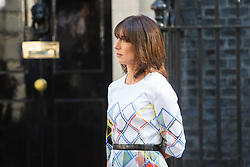 Downing Street, London, June 24th 2016. British Prime Minister David Cameron appears before the world's press gathered in Downing Street and announces that he will step aside with a new Prime Minister in place before the Party Conference, after the country votes to leave the European Union. PICTURED: Samantha Cameron looks on as her husband announces his resignation.