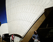 Tourists walk around The Sydney opera House