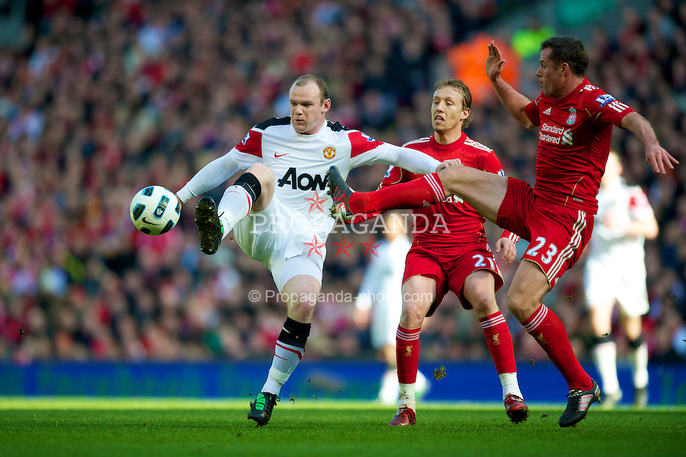 LIVERPOOL, ENGLAND - Sunday, March 6, 2011: Liverpool's Jamie Carragher and Manchester United's Wayne Rooney during the Premiership match at Anfield. (Photo by David Rawcliffe/Propaganda)
