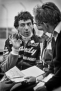 Italian Formula One driver Michele Alboreto is shown here being de-briefed after practice for the 1982 Detroit Grand Prix by Candy Team Tyrrell engineer Brian Lisles and team principle Ken Tyrrell. He would fail to finish the event, but would take Benetton Team Tyrrell to victory in the 1983 Detroit Grand Prix.<br />