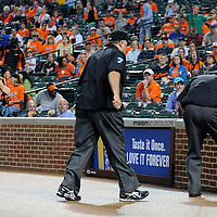 09 June 2009:  Umpires (L-R) Gary Cederstrom (3), Brain O'Nora (7) and Fieldin Culbreth go in to the tunnel to review a home run hit by Baltimore Orioles third baseman Melvin Mora in the 1st inning against the Seattle Mariners at Camden Yards in Baltimore, MD.  After the review, they ruled that a fan had interfered with the ball and the Mora was out.  The Orioles defeated the Mariners 3-1.  ****For Editorial Use Only****