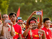 01 NOVEMBER 2015 - YANGON, MYANMAR: People use their smart phones to photograph Aung San Suu Kyi at the NLD's last election rally of the 2015 election in the Yangon suburbs Sunday. Political parties are wrapping up their campaigns in Myanmar (Burma). National elections are scheduled for Sunday Nov. 8. The two principal parties are the National League for Democracy (NLD), the party of democracy icon and Nobel Peace Prize winner Aung San Suu Kyi, and the ruling Union Solidarity and Development Party (USDP), led by incumbent President Thein Sein. There are more than 30 parties campaigning for national and local offices.    PHOTO BY JACK KURTZ
