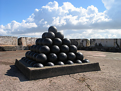 A stack of canon balls sits a top the fort at the San Juan National Historic Site, San Juan Puerto Rico<br />