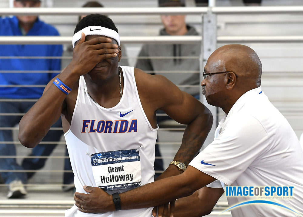Mar 11, 2017; College Station, TX, USA; Grant Holloway of Florida (left) embraces his father and Florida Gators coach Mike Holloway after winning the 60m during the NCAA Indoor Track and Field Championships at the Rhonda and Frosty Gilliam Jr. Indoor Track Stadium at the McFerrin Athletic Center.