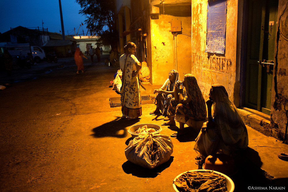 Fisherwomen gather at 4.30am, before the morning fish market begins at Vanakbara, Diu.