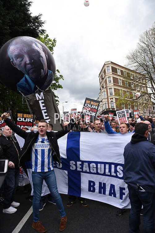 Charlton fans, joined by Brighton fans, protest against owner Roland Duchâtelet during the Sky Bet Championship match between Charlton Athletic and Brighton and Hove Albion at The Valley, London, England on 23 April 2016. Photo by David Charbit.