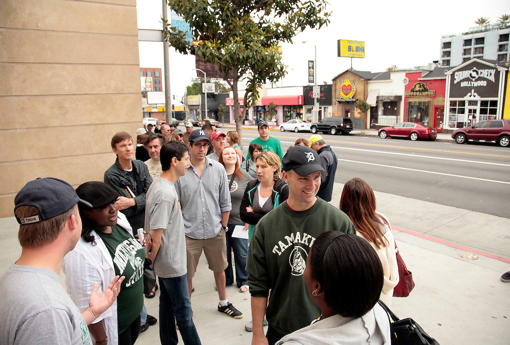 Customers wait for the opening of Coney Dog, a Detroit-style Coney Island hot dog restaurant, on Sunset Boulevard in West Hollywood, Calif., Saturday, June 19, 2011. (AP Photo/Jason Redmond)