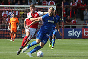 Fleetwood Town midfielder Jack Sowerby (28) grabs AFC Wimbledon striker Joe Pigott (39) round the neck to give away a free kick during the EFL Sky Bet League 1 match between Fleetwood Town and AFC Wimbledon at the Highbury Stadium, Fleetwood, England on 4 August 2018. Picture by Craig Galloway.
