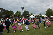 Members of the public join in dancing around the maypole with Members of the King Offa Dancers a, Thirteenth May Day Fair organised by local charity, Bexhill Old Town Preservation Society, Bexhill Old Town. 6 May 2019