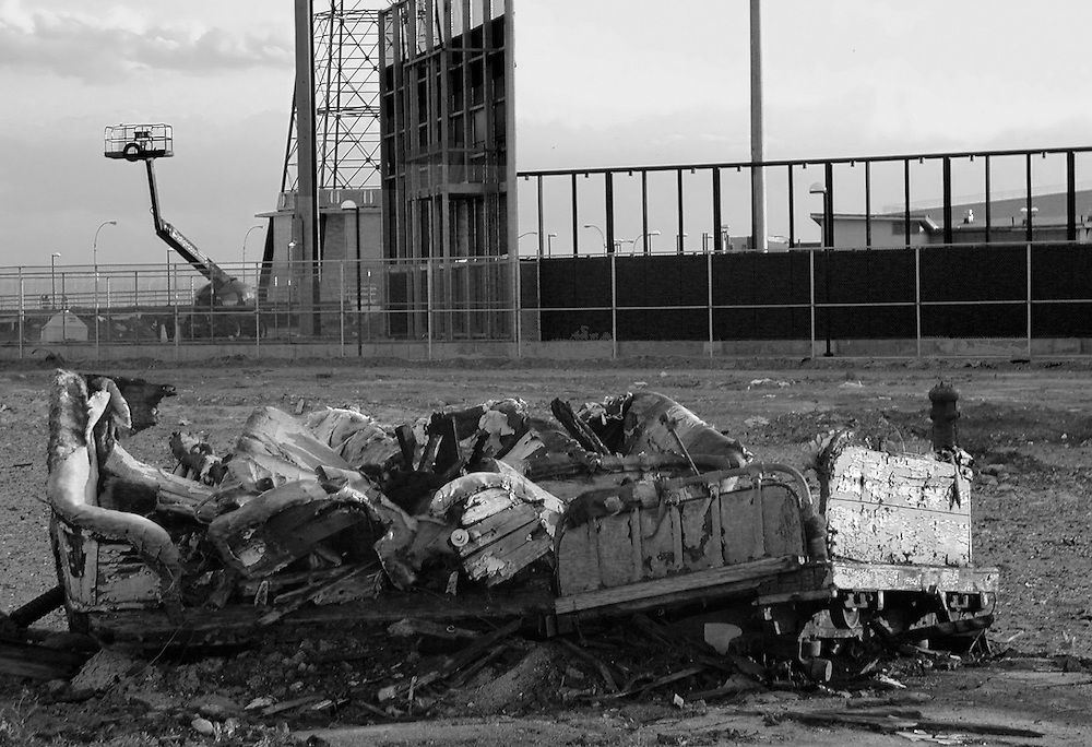 The ruins of a long gone wooden roller coaster car. The new Brooklyn Cyclones baseball park is in the background.