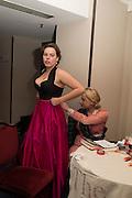 CHLOE SMITH HAVING EMERGENCY DRESS REPAIR FROM  EMILY ROSE WETHERELLThe Royal Caledonian Ball 2016. Grosvenor House. Park Lane, London. 29 April 2016