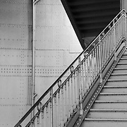 Black and white photograph of an architecture detail in the Cité station in the Paris Métro.