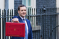 The Chancellor of The Exchequer George Osborne holds up the famous red dispatch box outside 11 Downing street on Budget Day in Westminster, London.<br /> Picture by Paul Davey/Focus Images Ltd +447966 016296<br /> 16/03/2016