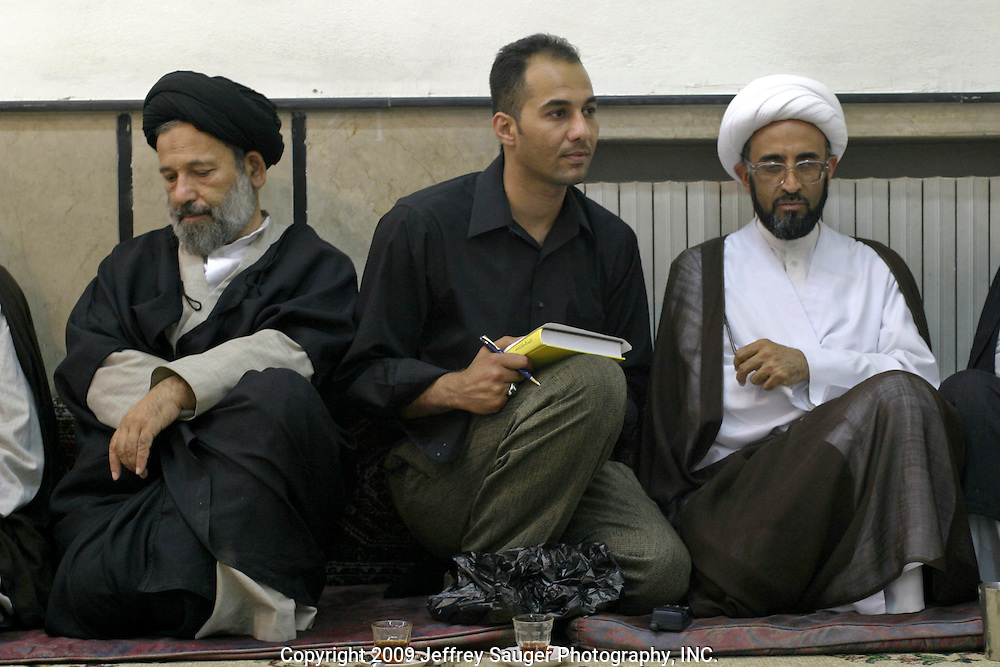 Emad Al-kasid meets with Shiite religious leaders as the men gather before prayer at the Howza of Ayotollah Shirazi the Iraqi area of Damascus, Syria, Wednesday, July 16, 2003. A Howza is like a seminary where men come to study. In this Shiite Howza, the philosophy of Ayotollah Shirazi is taught. As with all Shiite, advocacy of non-violence is the pre-eminent rule. Hundreds of thousands of Iraqi Shiite settled in Syria after the Gulf War and their uprising against Saddam Hussein in 1991.