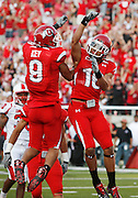 Utah's Aiona Key (9) celebrates with David Reed (16) following Reed's 42-yard reception for a touchdown against Louisville during the first quarter of an NCAA college football game at Rice-Eccles Stadium, Saturday Sept. 26, 2009, in Salt Lake City (AP Photo/Colin Braley)