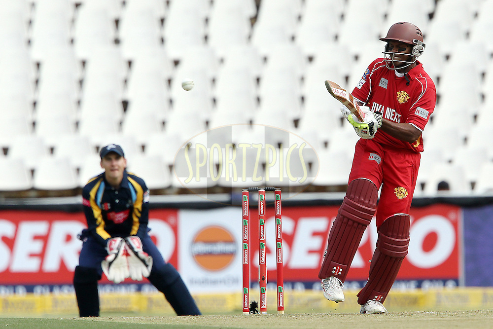 Shivnarine Chanderpaul knocks a four to bring up the hundred for Uva during 1st Qualifying match of the Karbonn Smart CLT20 South Africa between Uva Next and Yorkshire held at The Wanderers Stadium in Johannesburg, South Africa on the 9th October 2012..Photo by Ron Gaunt/SPORTZPICS/CLT20