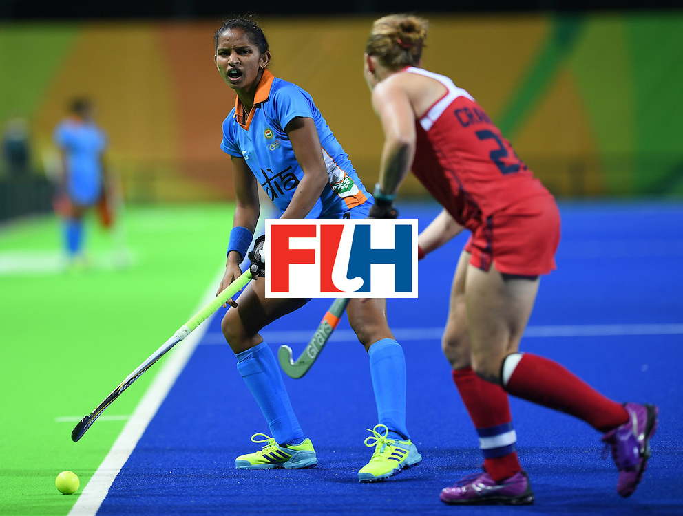 India's Navjot Kaur (L) looks to pass past the USA's Lauren Crandall during the women's field hockey USA vs India match of the Rio 2016 Olympics Games at the Olympic Hockey Centre in Rio de Janeiro on August, 11 2016. / AFP / MANAN VATSYAYANA        (Photo credit should read MANAN VATSYAYANA/AFP/Getty Images)