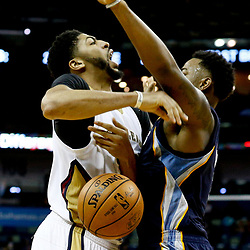 Dec 5, 2016; New Orleans, LA, USA; New Orleans Pelicans forward Anthony Davis (23) is fouled by Memphis Grizzlies forward Jarell Martin (1) during the second half of a game at the Smoothie King Center. The Grizzlies defeated the Pelicans 110-108 in double overtime.  Mandatory Credit: Derick E. Hingle-USA TODAY Sports