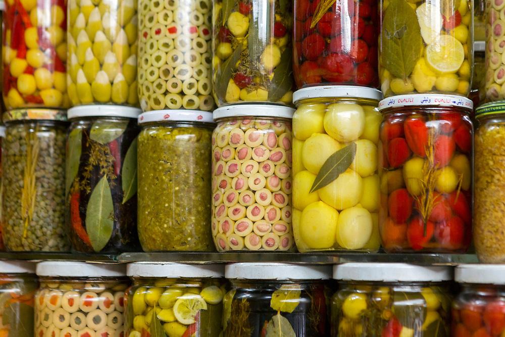 Preserved lemons, olives and pickles for sale at the food market behind Djemma el Fna main square Marrakech, 2018–05-27.