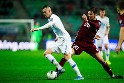 Josip Ilicic  of Slovenia vs Roberts Uldrikis  of Latvia during the 2020 UEFA European Championships group G qualifying match between Slovenia and Latvia at SRC Stozice on November 19, 2019 in Ljubljana, Slovenia. Photo by Vid Ponikvar / Sportida