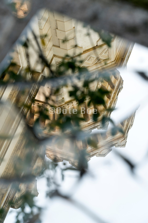 broken mirror with a chateau building and nature leaves reflecting